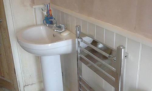 Bathroom sink and radiator installation